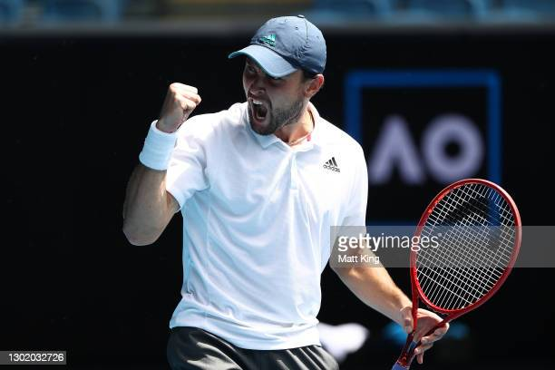 Aslan Karatsev of Russia celebrates after winning a point in his Men's Singles fourth round match against Felix Auger-Aliassime of Canada during day...