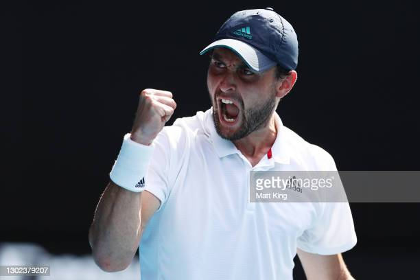 Aslan Karatsev of Russia celebrates after winning a point in his Men's Singles Quarterfinals match against Grigor Dimitrov of Bulgaria during day...