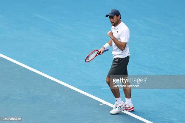Aslan Karatsev of Russia celebrates winning match point in his Men's Singles Quarterfinals match against Grigor Dimitrov of Bulgaria during day nine...
