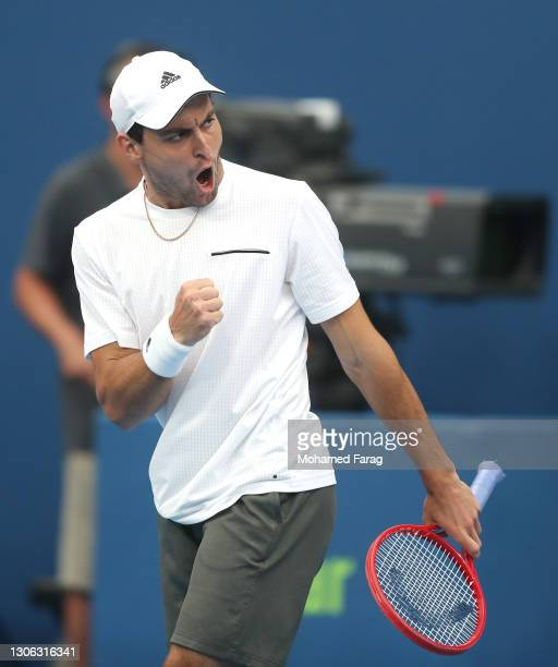 Aslan Karatsev of Russia celebrates winning the first set during his round of 16 match against Dominic Thiem of Austria during Day Three of the Qatar...