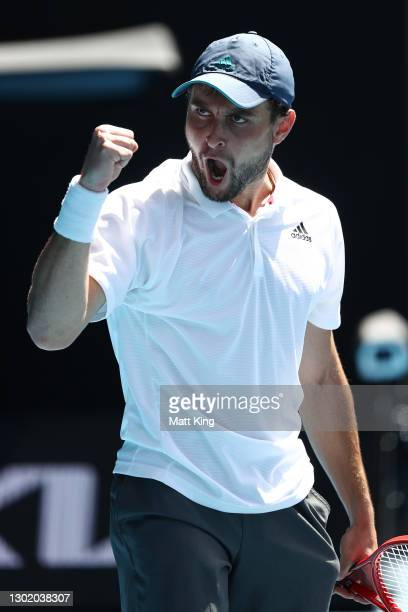 Aslan Karatsev of Russia celebrates winning the fourth set in his Men's Singles fourth round match against Felix Auger-Aliassime of Canada during day...