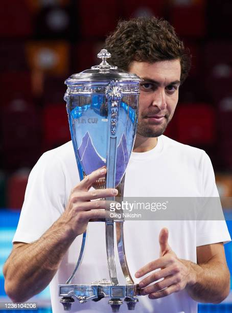 Aslan Karatsev of Russia celebrates with the trophy after winning the women's singles final match agains Marin Cilic of Croatia during on Day Seven...