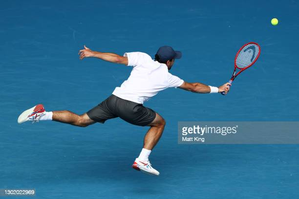 Aslan Karatsev of Russia plays a backhand in his Men's Singles fourth round match against Felix Auger-Aliassime of Canada during day seven of the...