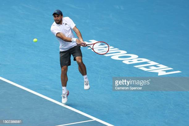Aslan Karatsev of Russia plays a backhand in his Men's Singles Quarterfinals match against Grigor Dimitrov of Bulgaria during day nine of the 2021...