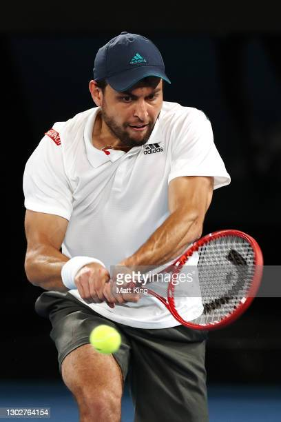 Aslan Karatsev of Russia plays a backhand in his Men's Singles Semifinals match against Novak Djokovic of Serbia during day 11 of the 2021 Australian...