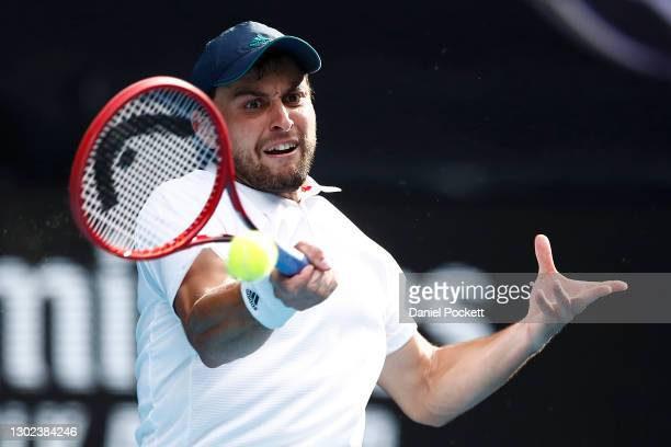 Aslan Karatsev of Russia plays a forehand in his Men's Singles Quarterfinals match against Grigor Dimitrov of Bulgaria during day nine of the 2021...