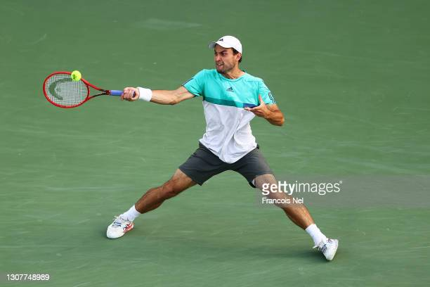 Aslan Karatsev of Russia plays a forehand in his Quarter-Final singles match against Jannik Sinner of Italy during Day Twelve of the Dubai Duty Free...