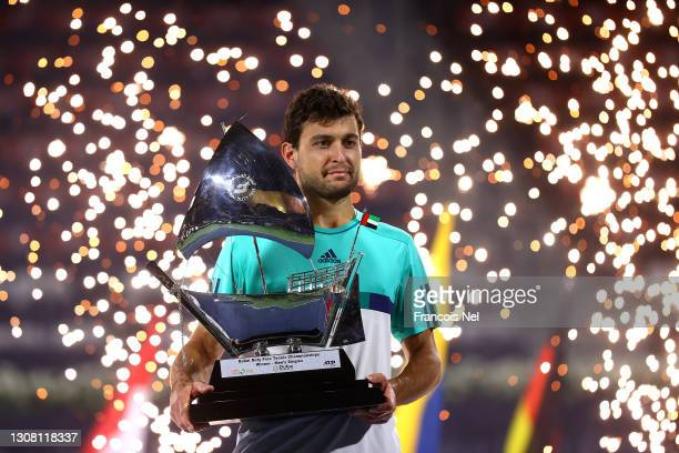 Aslan Karatsev of Russia poses with the trophy after beating Lloyd Harris of South Africa to win the men's singles Final match during day fourteen of...