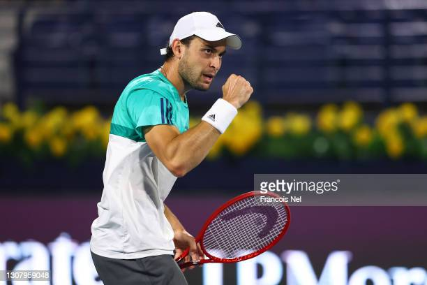 Aslan Karatsev of Russia reacts during his men's singles Semi Final match against Andrey Rublev of Russia on Day Thirteen of the Dubai Duty Free...