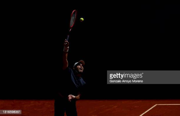 Aslan Karatsev of Russia serves during his third round match against Alexander Bublik of Kazakhstan during day eight of the Mutua Madrid Open at La...