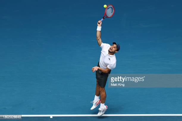 Aslan Karatsev of Russia serves in his Men's Singles fourth round match against Felix Auger-Aliassime of Canada during day seven of the 2021...