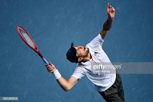 Aslan Karatsev of Russia serves in his Men's Singles Quarterfinals match against Grigor Dimitrov of Bulgaria during day nine of the 2021 Australian...