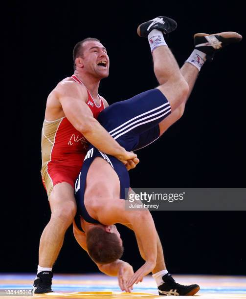Aslanbek Khushtov of Russia lifts Vilius Laurinatis of Lithuania upside down in a 96k Men's GrecoRoman bout during the Wrestling LOCOG Test Event for...