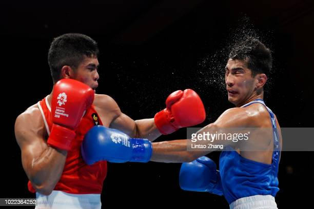 Aslanbek Shymbergenov of Kazakstan competes against Sarohatua Lumbantobing of Indonesia in the Men's 69kg Round of Boxing event at the Jiexpo Hall on...