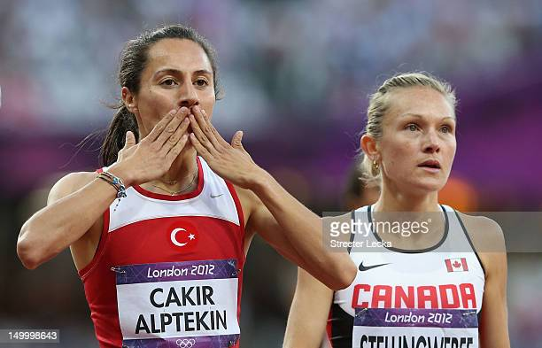 Asli Cakir Alptekin of Turkey celebrates after competing in the Women's 1500m Semifinals on Day 12 of the London 2012 Olympic Games at Olympic...