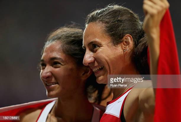 Asli Cakir Alptekin of Turkey celebrates with silver medalist Gamze Bulut of Turkey after the Women's 1500m Final on Day 14 of the London 2012...