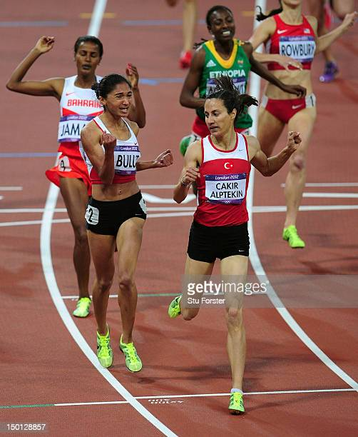 Asli Cakir Alptekin of Turkey crosses the line to win gold ahead of silver medalist Gamze Bulut of Turkey and bronze medalist Maryam Yusuf Jamal of...