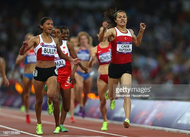Asli Cakir Alptekin of Turkey Gamze Bulut of Turkey and Maryam Yusuf Jamal of Bahrain cross the finish line during the Women's 1500m Final on Day 14...