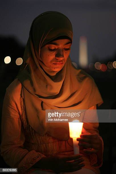 Asma Azam takes part as the Council on American-Islamic Relations holds an interfaith candlelight vigil marking the fourth anniversary of the 9/11...