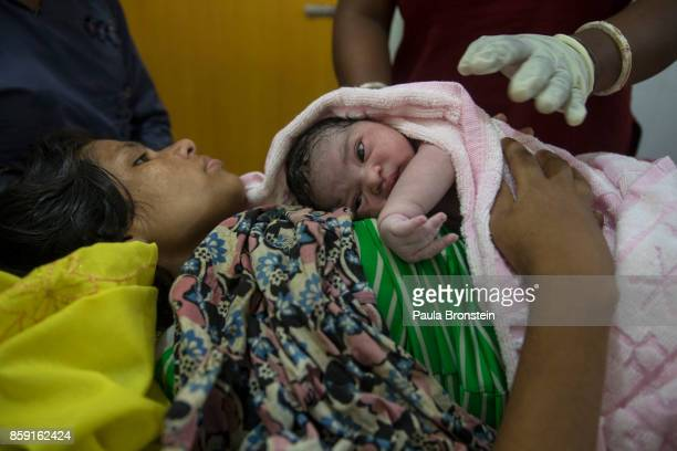 Asma holds her newborn baby girl in the birthing unit at the 'Doctors Without Borders' Kutupalong clinic on October 3 2017 in Cox's Bazar Bangladesh...