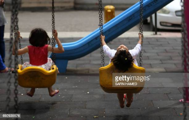Asmaa and Kawthar two displaced Iraqi sisters from Mosul play at an orphanage in Arbil the capital of the Kurdish autonomous region in northern Iraq...