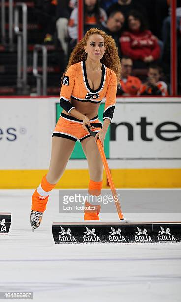 Asmaa Harakat of the Philadelphia Flyers ice girls cleans the ice during a stoppage in play against the Tampa Bay Lightning on January 11 2014 at the...