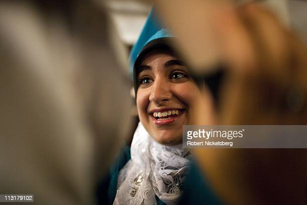 Asmaa Rimawi, 17 years, attends her high school graduation ceremony from the al-Noor School, a private Islamic institution, June 23, 2010 in...