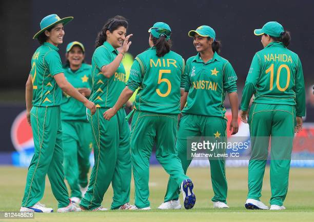 Asmavia Iqbal of Pakistan is congratulated on the wicket of Kycia Knight of the West Indies after she was caught by Sidra Nawaz during the ICC...