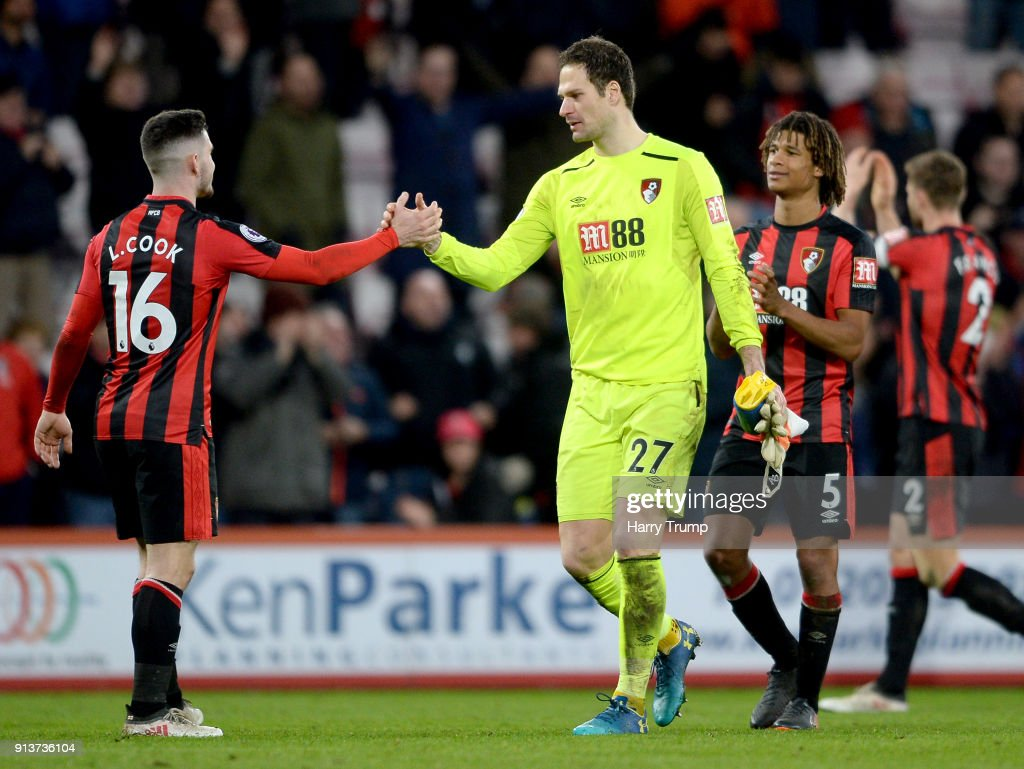 Asmir Begovic of AFC Bournemouth and Lewis Cook of AFC Bournemouth embrace after the Premier League match between AFC Bournemouth and Stoke City at Vitality Stadium on February 3, 2018 in Bournemouth, England.