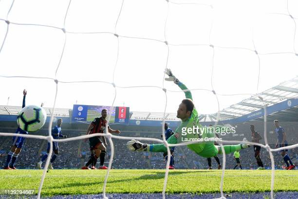 Asmir Begovic of AFC Bournemouth looks on as Wes Morgan of Leicester City scores his team's first goal during the Premier League match between...