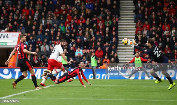 Asmir Begovic of AFC Bournemouth saves a header from Charlie Austin of Southampton during the Premier League match between AFC Bournemouth and...
