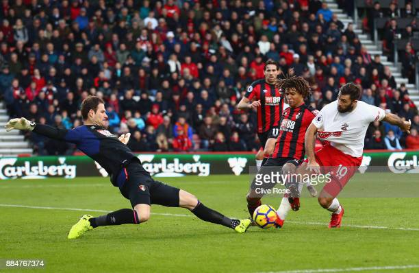 Asmir Begovic of AFC Bournemouth saves from Charlie Austin of Southampton who is challenged by Nathan Ake of AFC Bournemouth during the Premier...