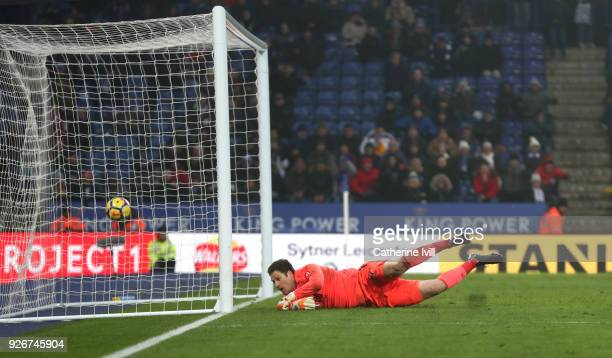 Asmir Begovic of AFC Bournemouth watches Riyad Mahrez of Leicester City's goal cross the line during the Premier League match between Leicester City...