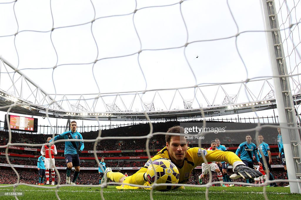 Asmir Begovic of Stoke City fails to stop the ball crossing the line as Alexis Sanchez (not pictured) of Arsenal scores his team's third goal from a freekick during the Barclays Premier League match between Arsenal and Stoke City at Emirates Stadium on January 11, 2015 in London, England.