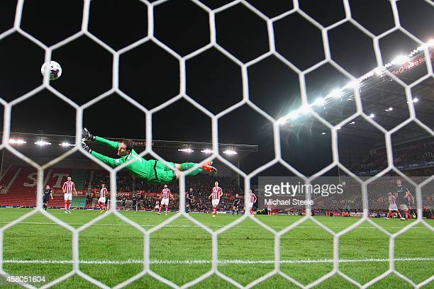 Asmir Begovic of Stoke City is beaten by a shot from Graziano Pelle of Southampton to concede the opening goal during the Capital One Cup Fourth...