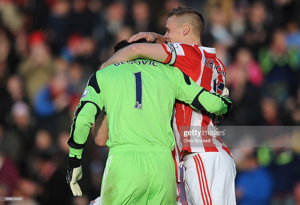 Asmir Begovic (L) of Stoke City is congratulated by team-mate Ryan Shawcross after scoring the opening goal during the Barclays Premier League match between Stoke City and Southampton on November 02, 2013 in Stoke on Trent, England.
