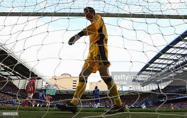 Asmir Begovic of Stoke City looks dejected during the Barclays Premier League match between Chelsea and Stoke City at Stamford Bridge on April 25...