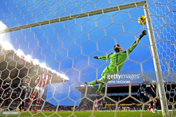 Asmir Begovic of Stoke City makes a save during the Barclays Premier League match between Stoke City and Manchester United at Britannia Stadium on...