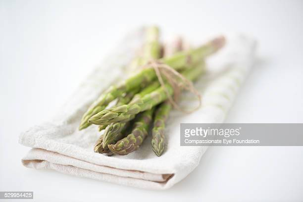 "asparagus on cloth - ""compassionate eye"" stock-fotos und bilder"