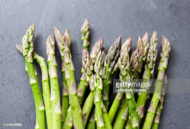 asparagus on dark background - asparagus stock pictures, royalty-free photos & images
