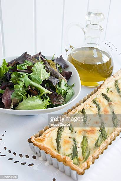 Asparagus quiche with salad and olive oil