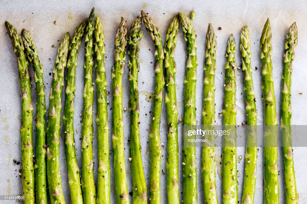 Asparagus Spears on Oven Tray ready for Roasting : Stock Photo