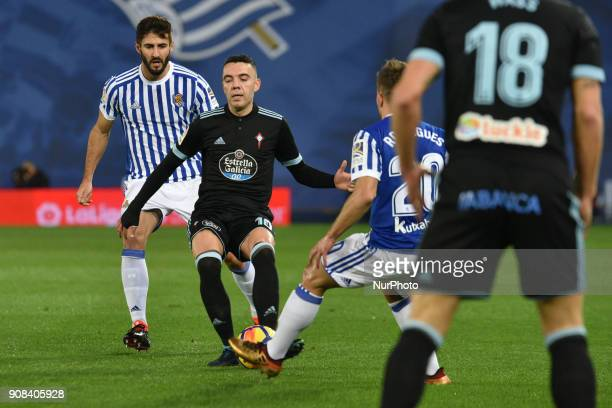 Aspas of Celta duels for the ball with Kevin Rodrigues and Raul Navas of Real Sociedad during the Spanish league football match between Real Sociedad...