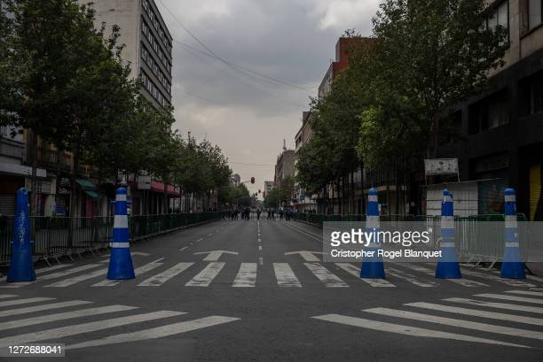 Aspects of an empty street in the historic center of Mexico City The authorities placed filters to prevent the passage of people and thus avoid...