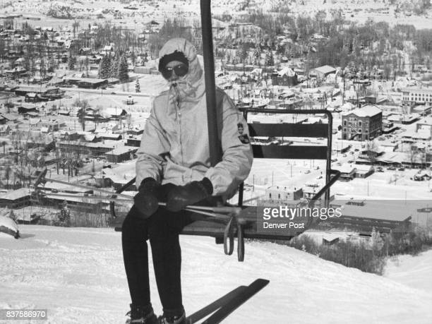 Aspen Clocks Run on Ski Lift Time A skier rides the lift on Aspen Mountain leaving the town of Aspen Colo far below His pace is set by the ski lift...
