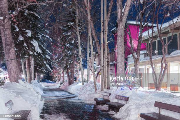 aspen colorado night street scene with holiday nlights - aspen colorado stock pictures, royalty-free photos & images