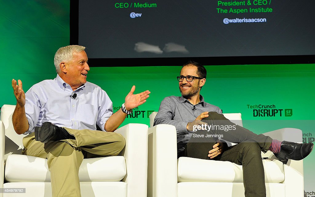 Aspen Institute President and CEO Walter Isaacson (L) and Medium CEO Evan Williams speak onstage at TechCrunch Disrupt at Pier 48 on September 8, 2014 in San Francisco, California.