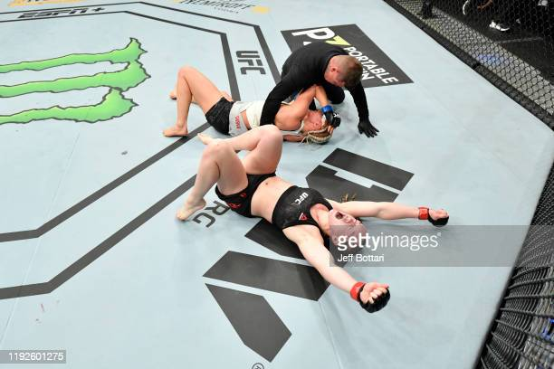 Aspen Ladd celebrates her TKO victory over Yana Kunitskaya of Russia in their women's bantamweight bout during the UFC Fight Night event at Capital...