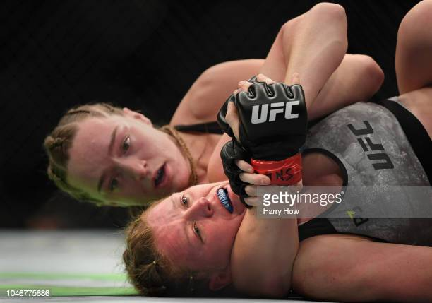Aspen Ladd has a choke hold on Tonya Evinger in their women's bantamweight bout during the UFC 229 event inside TMobile Arena on October 6 2018 in...