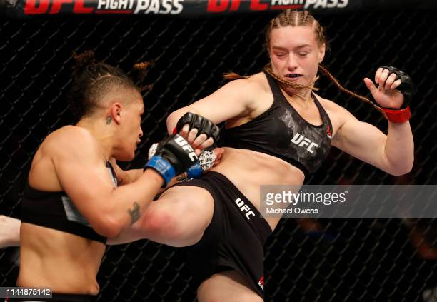 Aspen Ladd kicks Sijara Eubanks in their women's bantamweight bout during the UFC Fight Night event at Blue Cross Arena on May 18 2019 in Rochester...